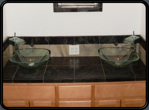 Glass vanities, polished slate and walnut cabinet