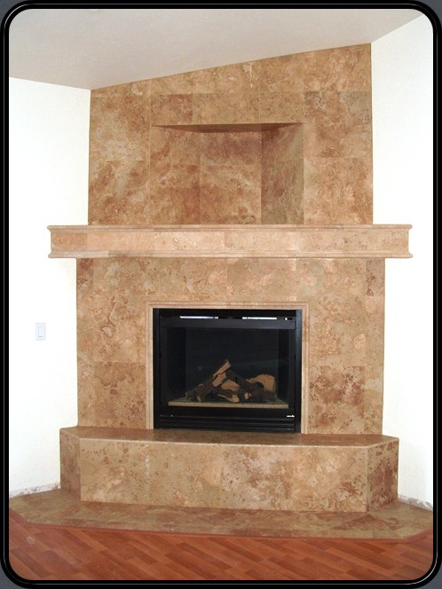 Travertine Stone clad fireplace with shelf inset