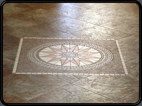 Mosaic inlay on diamond set entry way.
