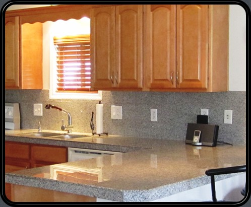 Luna Pearl granite stone tiles on countertop and backsplash