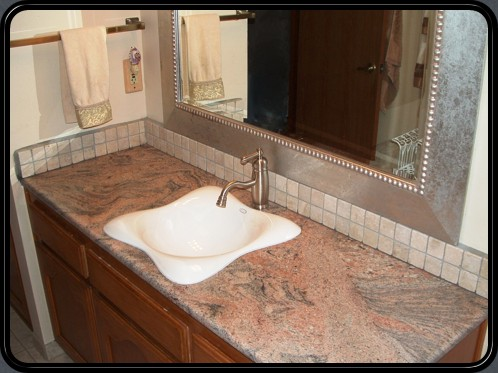 Wave pattern sink set in solid granite