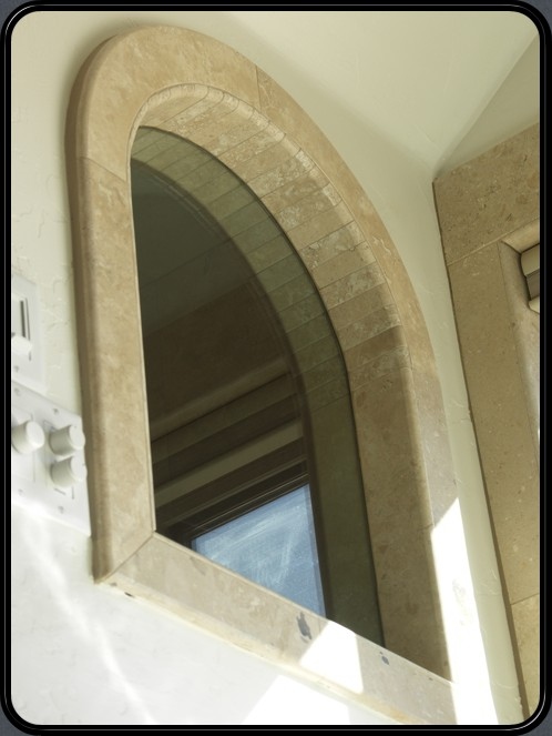 Window framed in natural Travertine stone, outdoors